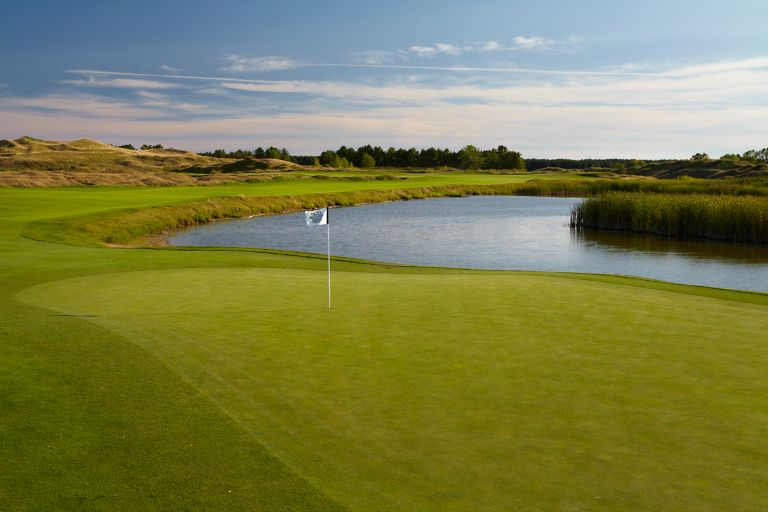 The fifth hole on the Straits Course at Whistling Stratis is the longer of the two par 5s on the front nine,  demanding accuracy from tee to green.