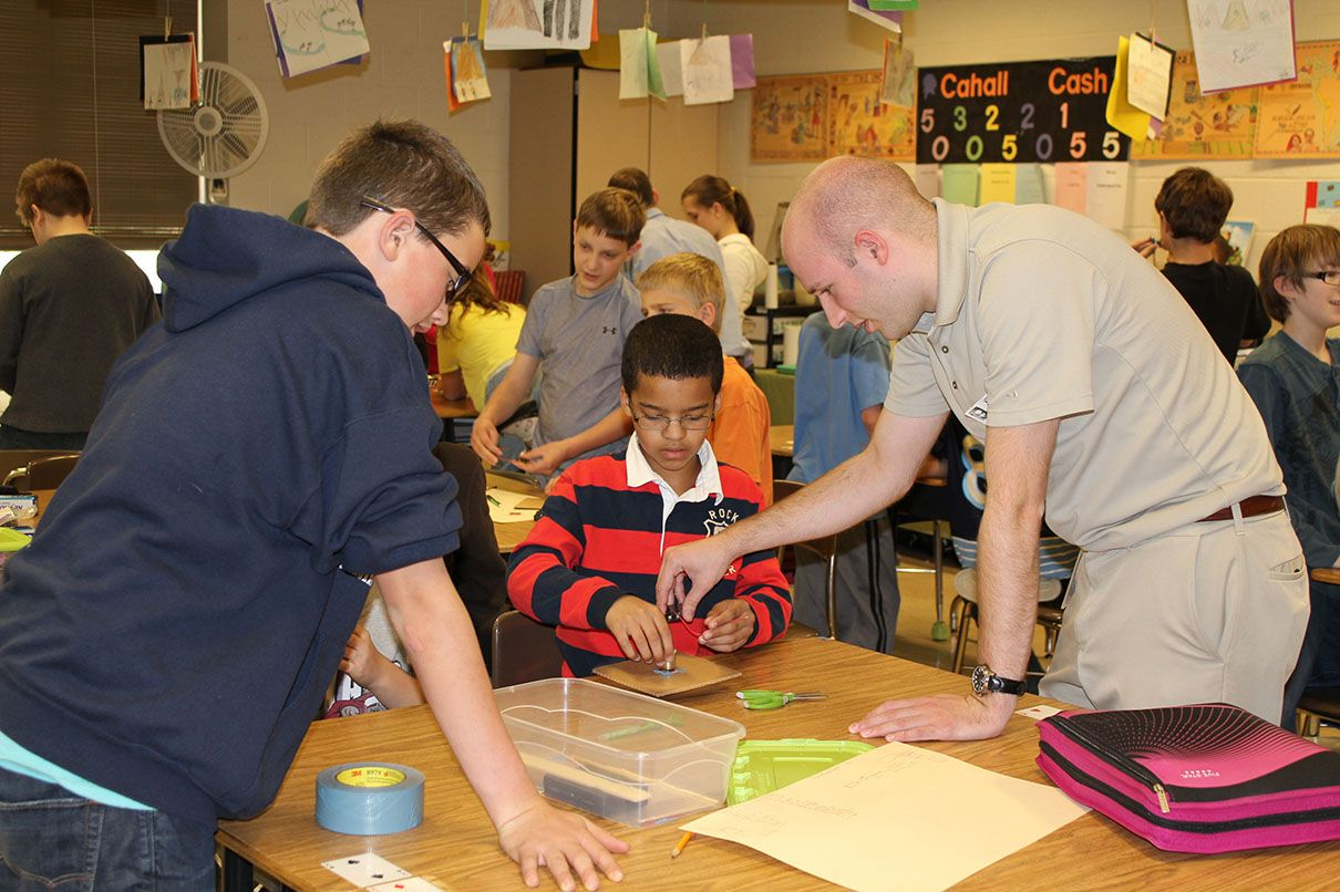 MSA employees help kids at a STEM event in a local classroom