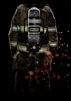 The back of a firefighter wearing a MSA supplied-air respirator