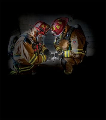 Firefighters wearing the MSA ExtendAire II SCBA
