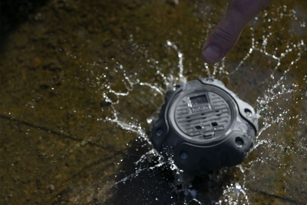 The ALTAIR io360 Gas Detector is dropped into a puddle with a splash