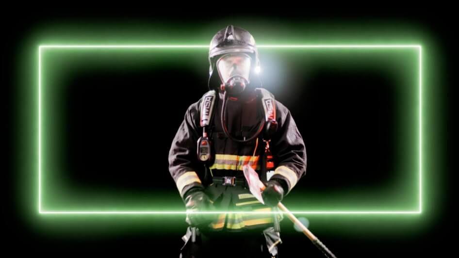 A rectangular neon light wrapped around a firefighter.