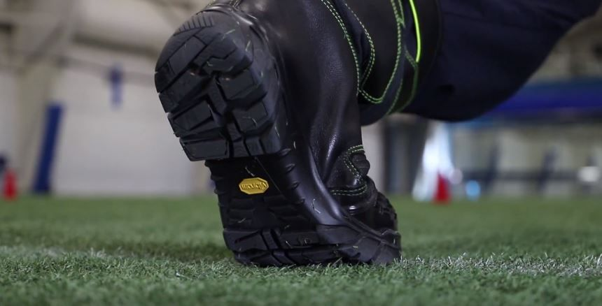 Close up of a firefighter bending in a SUPRAFLEX fire boot