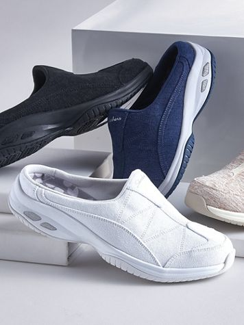 Skechers® Commute Time Solid Slip-Ons - Image 1 of 3