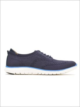 Tricia Wingtip Knit Sneakers by Hush Puppies®