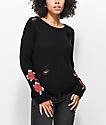 Almost Famous Sally suéter negro y destruido con rosas
