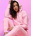 Champion Allover Logo sudadera con capucha rosa de tejido inverso