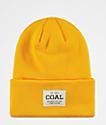 Coal Uniform gorro dorado