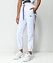FILA Diana pantalones de chándal blancos con cremalleras tobilleras
