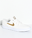 Nike SB Janoski zapatos de skate de lienzo en blanco y color marrón oro