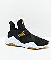 PUMA Defy Varsity zapatos en negro y oro