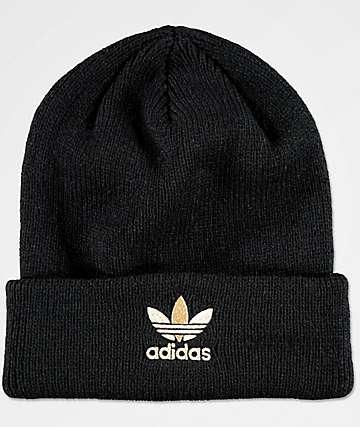 Adidas gorro negro y oro metálico