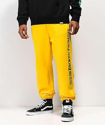 Broken Promises Bad Behavior pantalones deportivos dorados