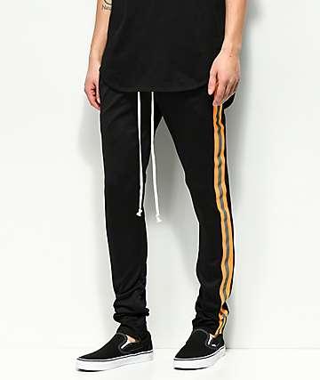 EPTM. pantalones de chándal reflectantes en negro y naranja