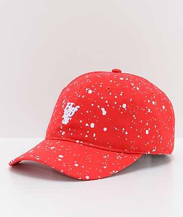 HUF gorra strapback en  rojo con salpicaduras blanqueadas
