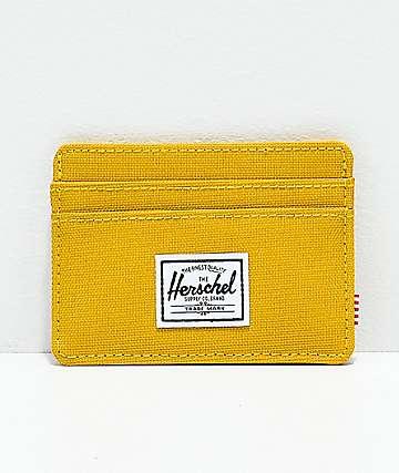 Herschel Supply Co. Charlie Arrowhead cartera amarillo