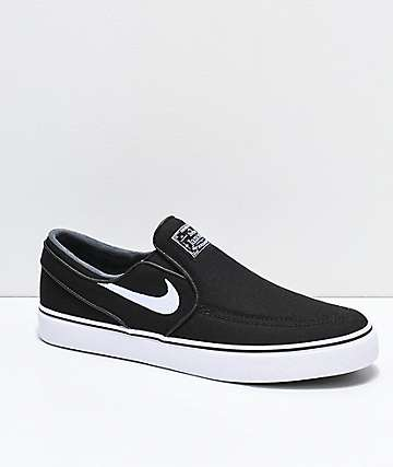 5fe15823e2e41a Nike SB Janoski Black   White Canvas Slip-On Skate Shoes