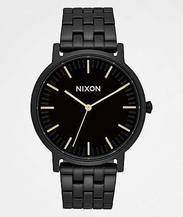 Nixon Porter reloj analógico en negro y oro