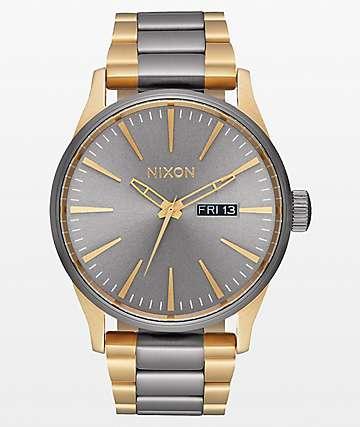 Nixon Sentry SS reloj analógico en gris metalizado y oro