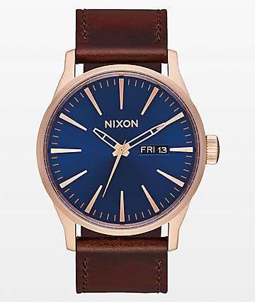 Nixon Sentry reloj analógico de oro rosa, azul marino y marrón