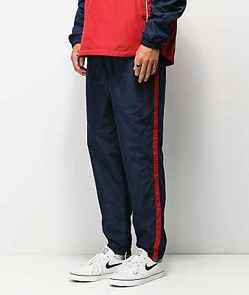 Primitive Relay pantalones de chándal azul y rojo