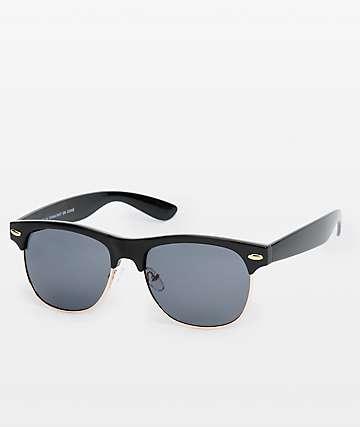 Retro gafas de sol en negro y oro