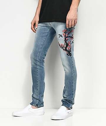 Rustic Dime Cherry Blossom jeans en azul claro con bordados