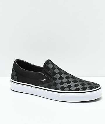 black and grey vans slip on