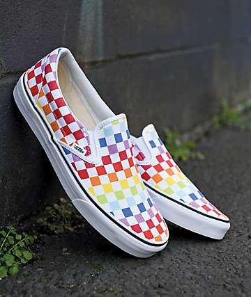 c8eb72057a Vans Slip-On Rainbow Checkerboard Skate Shoes