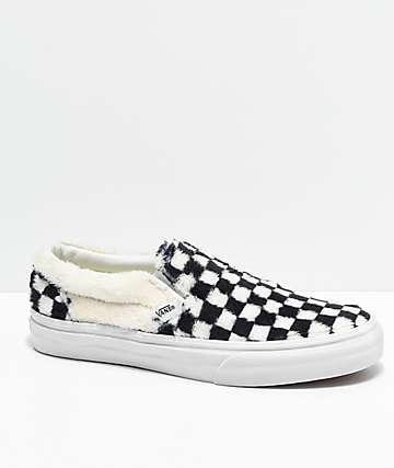 Vans Slip-On zapatos de skate a cuadros en negro y blanco de sherpa