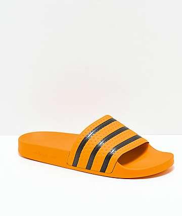 adidas Adilette sandalias doradas y negras