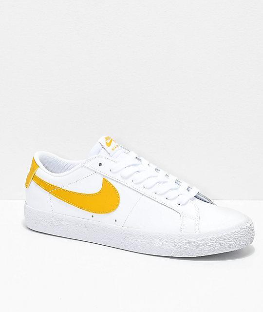 Nike SB Blazer Zoom Low White & Gold Leather Skate Shoes | Zumiez