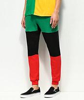 Cross Colours pantalones jogger con diseño color block en verde, negro y rojo
