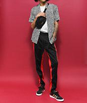 Ninth Hall Nordberg pantalones de chándal en negro y rojo