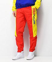 Odd Future pantalones cortavientos rojos y amarillos