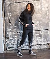 Vans Checkerboard Flame pantalones deportivos en negro